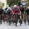 Ben Swift, right, finished third as Alexander Kristoff, centre, sprinted to victory