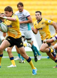 Beauden Barrett of the Hurricanes beats the tackle of Cheetahs