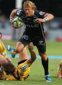 Charl McLeod on a run for the Sharks