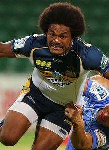 Henry Speight of the Brumbies looks to break from a tackle by Nick Cummins of the Force