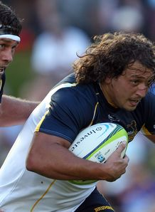 JP Smith of the Brumbies carries the ball
