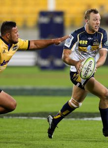 Jesse Mogg Brumbies evades the defence v Hurricanes
