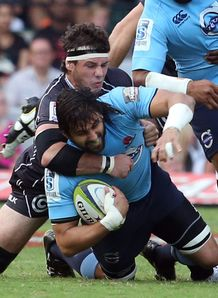 Marcell Coetzee of the Cell C Sharks tackling Jacques Potgieter of the Waratahs