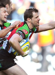 Nick Evans R of Harlequins celebrates his try with Danny Care