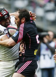 Toulouse flanker Akapusi Qera L vies for the ball with Stade Francais Julien Dupuy