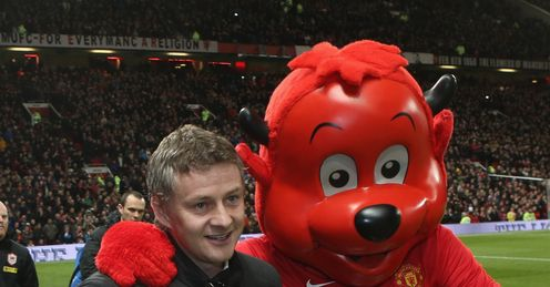 Ole Gunnar Solskjaer is enjoying Fred the Red's company, but Johnny is not a mascot fan