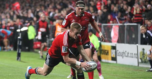 Johnny McNicholl of the Crusaders dives over to score a try