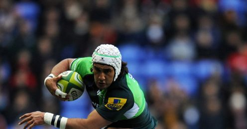 Blair Cowan of London Irish is tackled by Dave Attwood of Bath