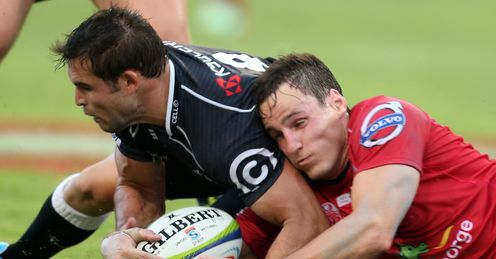 Cobus Reinach of the Cell C Sharks and Mike Harris of the Reds