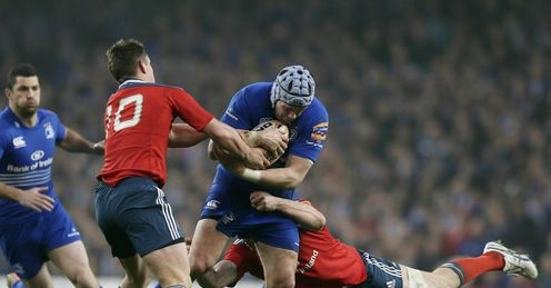 Leinster s Shane Jennings is tackled by Munster s Tommy O Donne