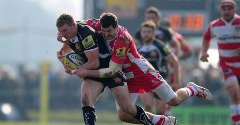 Matt Jess of Exeter Chiefs is tackled by Jonny May of Gloucester