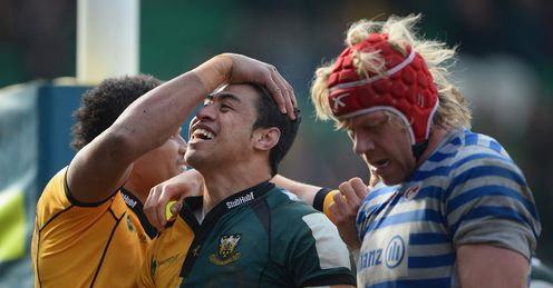 Northampton centre George Pisi congratulated standing next to Saracens lock Mouritz Botha