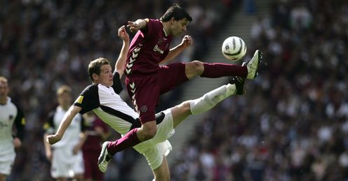 GLASGOW, UNITED KINGDOM - MAY 13:  Takis Fyssas of Hearts battles with Kenny Deuchar of Gretna during the Tennents Scottish Cup Final between Heart of Midl