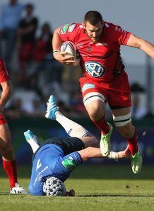 Daniel Rossouw of Toulon moves past Shane Jennings