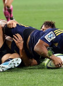 Highlanders fly half Lima Sopoago going over for a try