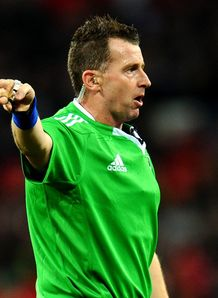 Referee Nigel Owens officiates during the Heineken Cup