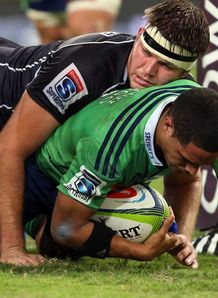 Sharks lock Stephan Lewies on top of Highlanders scrum half Aaron Smith