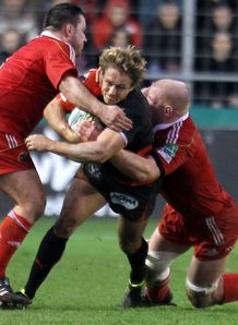 Toulon fly half Jonny Wilkinson being tackled against Munster in 2011