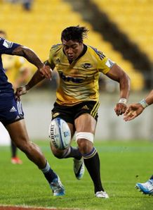 julian savea kicks ahead hurricanes v blues 2014