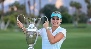 Me and my trophy: Winner Lexi Thompson with the silverware
