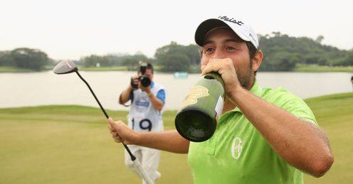 Alexander the great: Frenchman Levy knocks back the champagne after winning in China