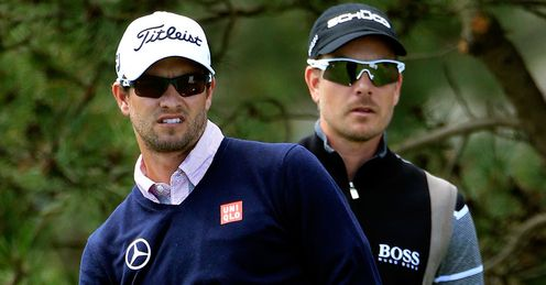 Henrik Stenson (right) is one player aiming to overtake champion Adam Scott