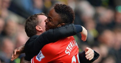 Brendan Rodgers and Raheem Sterling celebrate