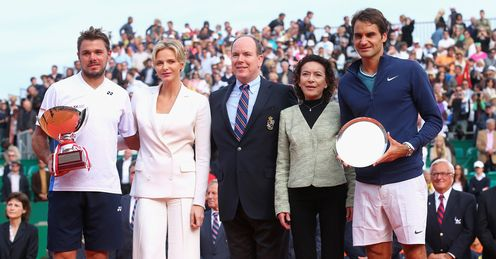 Wawrinka receives his Monte Carlo Masters trophy from Prince Albert and Princess Charlene of Monaco.
