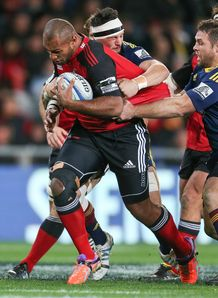 Nemani Nadolo of the Crusaders is tackled by Highlanders