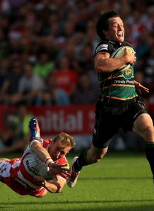 Northampton Saints Jamie Elliott evades the tackle of Gloucester s Dan Robson to score