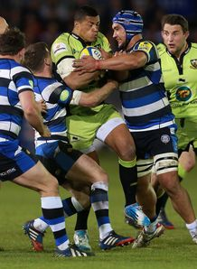 Northampton s Luther Burrell is tackled by Bath s George Ford and Leroy Houston 2014