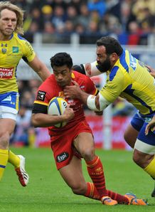 Perpignan s Lifeimi Mafi C is tackled by Clermont s Davit Zirakashvili