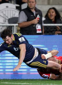 Richard Buckman of the Highlanders scores a try v Lions