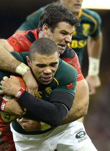 Wales scrum half Mike Phillips tackling South Africa s Bryan Habana