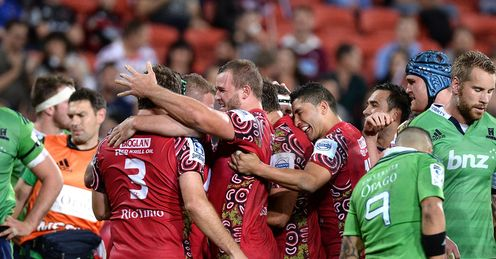 Reds pack celebrate try v Highlanders