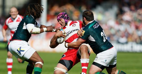 Sione Kalamafoni of Gloucester is tackled by Gerard Ellis of London Irish R