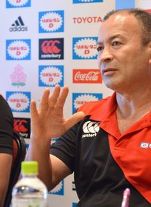 Japan coach Eddie Jones R speaks during a press conference