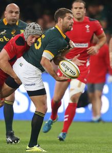 Jonathan Davies of Wales with a tackle on Willie le Roux of South Africa