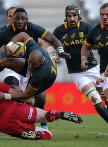 South Africa s wing Cornal Hendricks C is tackled by Wales