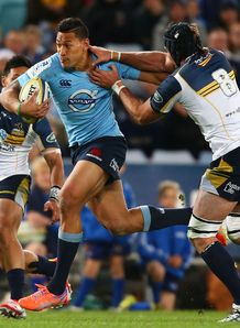 Waratahs full back Israel Folau fending against Brumbies