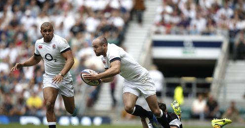 Barbarians Tomas Cubelli R tackles England s left wing Charlie Sharples