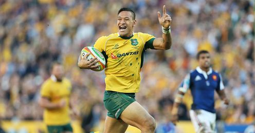 Israel Folau of the Wallabies celebrates as he runs in to score Australia v France