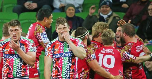 Reds celebrating Nick Frisby try against the Rebels
