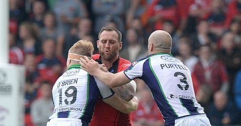 RUGBYL SALFORD SALFORD RED DEVILS' GARETH HOCK IS TACKLED BY BRADFORD BULLS
