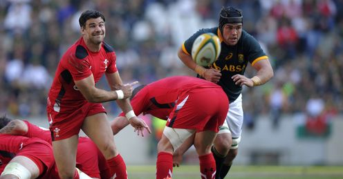 WALES SCRUM-HALF MIKE PHILLIPS (L) CLEARS THE BALL OUT OF A SCRUM