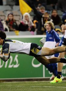 Brumbies back Matt Toomua diving over for a try