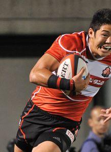 Japan s Yoshikazu Fujita C scores a try against Samoa