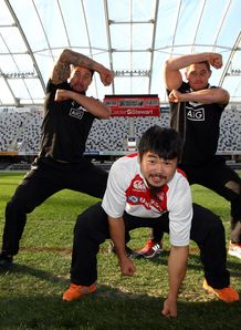 Maori All Blacks break into a Haka while Fumiaki Tanaka of Japan takes a Sumo stance