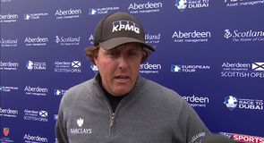 Mickelson makes birdie from the cart path