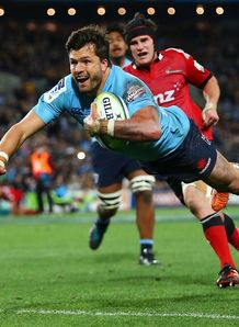 Adam Ashley Cooper of the Waratahs dives to score a try v Crusaders